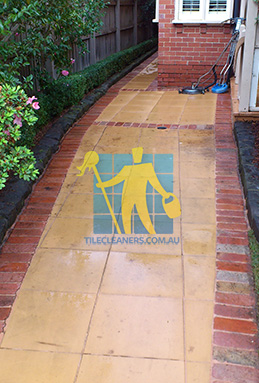 outdoor sandstone tiles pavers wet from cleaning with quarry tiles around Gawler